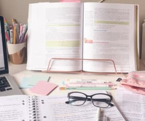 book, glasses, and notebooks image