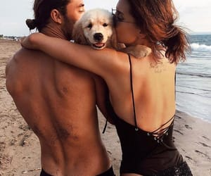 couple, dog, and beach image