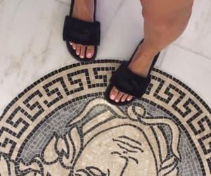 Versace, puma, and luxury image