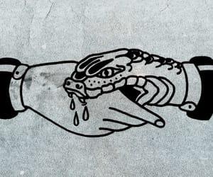 handshake, snake, and betrayal image