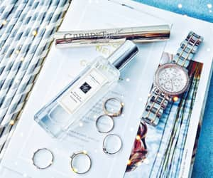 cosmetics, earrings, and guess image