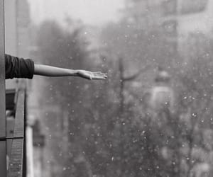 black and white, hand, and city image