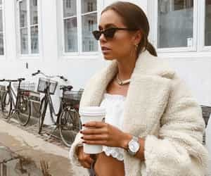 coat, sunglasses, and coffee image
