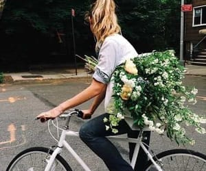 flowers, girl, and bike image