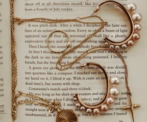 book, gold, and earrings image