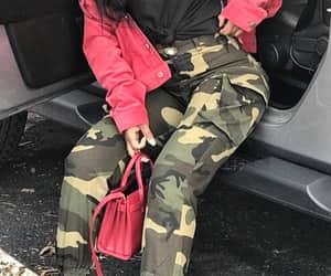 red purse, camo pants, and long wavy black hair image