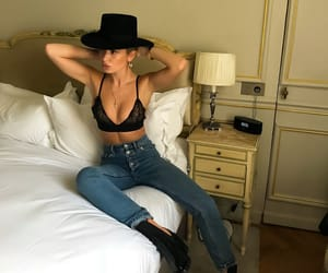 black boots, bralette, and hat image