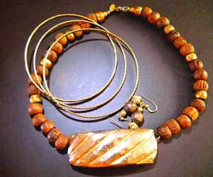 gold bracelets, brown necklace, and goldplate image