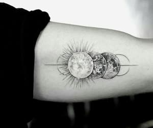 planet and tattoo image