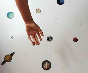 hand and planets image