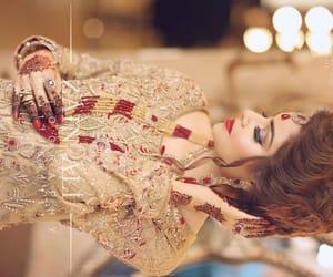 henna, red nail polish, and wedding image