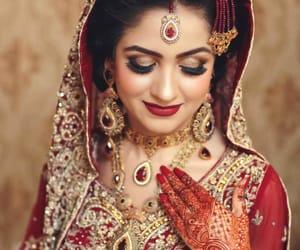 henna, red nail polish, and indian bride image
