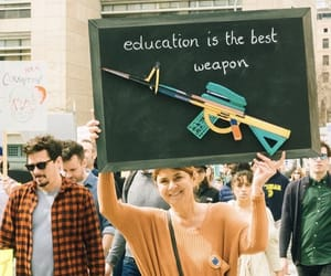 feminism, gun control, and march image