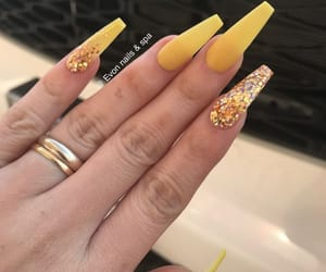 nails, yellow, and claws image