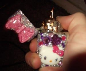 hello kitty and lighter image