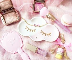 eye mask, lip gloss, and makeup image