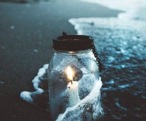 candle, sea, and light image