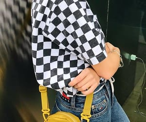 blue jeans, yellow bags, and checkered t-shirts image