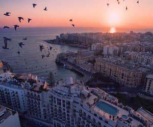 city, sea, and sunset image