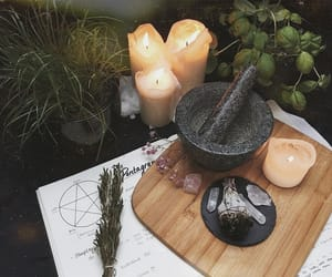 candle, crystal, and herbs image