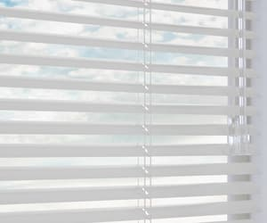 venetian blinds, roman curtains, and modern curtains image