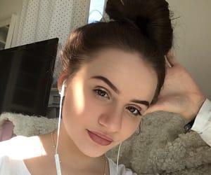 brown hair, bun, and eyes image