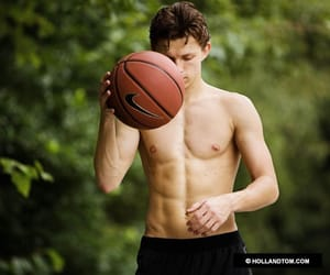 tom holland, spiderman, and abs image