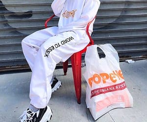 white pants, white hoodies, and skechers sneakers image