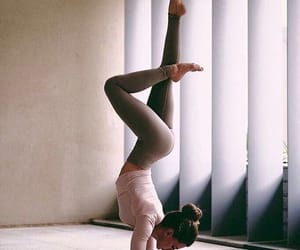 body, bun, and handstand image