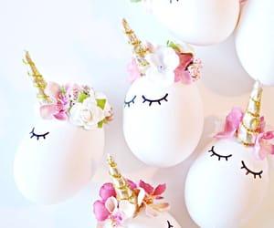 unicorn, egg, and flowers image