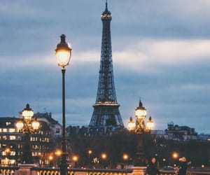 blue, cloudy, and eiffel tower image