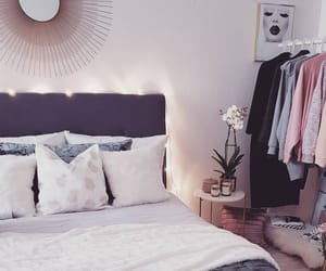 bed, bedroom, and clothes rack image