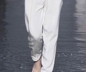 details and white pants image