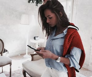 blue shirt, red sweater, and white jeans image
