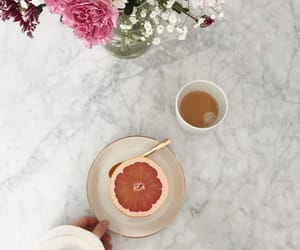 coffee, grapefruit, and flowers image