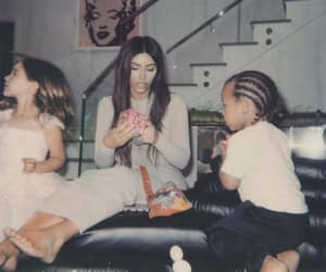 kim kardashian, saint west, and baby image