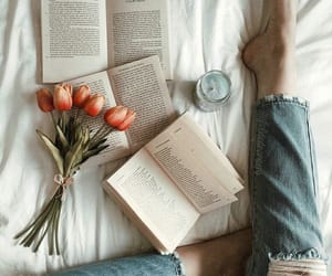 books, candles, and flowers image