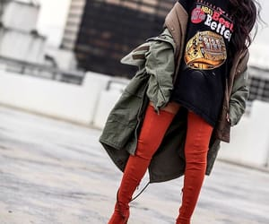 long wavy brown hair, red thigh high boots, and long green jackets image