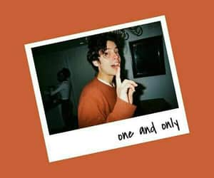 cole sprouse, orange, and wallpaper image