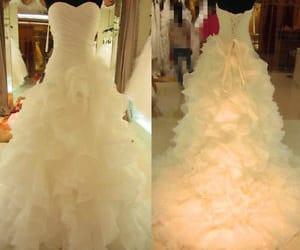 bridal dress and ruffled wedding dress image