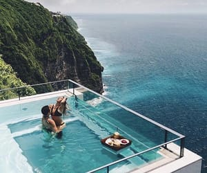 couple, travel, and pool image