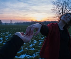 sunset, couple, and hands image