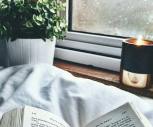 book, candle, and rain image