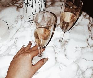 marble, nails, and wine image