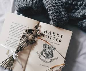 article, wand, and book image