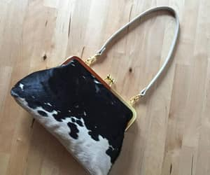 black clutch, clutch, and evening bag image