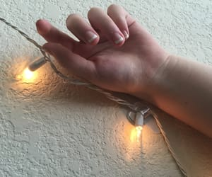 hand, peachy, and lights image