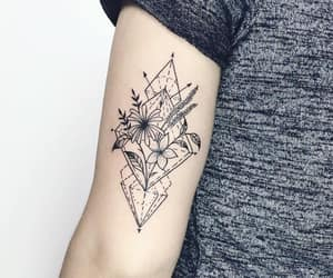 arm tattoo, flowers, and black and grey tattoo image