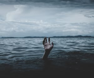 hand, blue, and drowning image