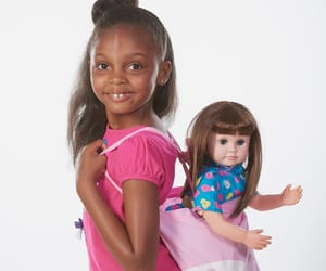 american girl doll, baby doll, and interactive doll image